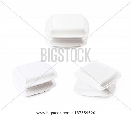Two white food delivery containers made of styrofoam, composition isolated over the white background, set of three different foreshortenings
