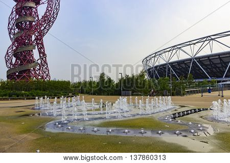 London England - May 27 2016: The ArcelorMittal Orbit observation tower and the Olympic stadium in the Queen Elizabeth Olympic Park in London England.
