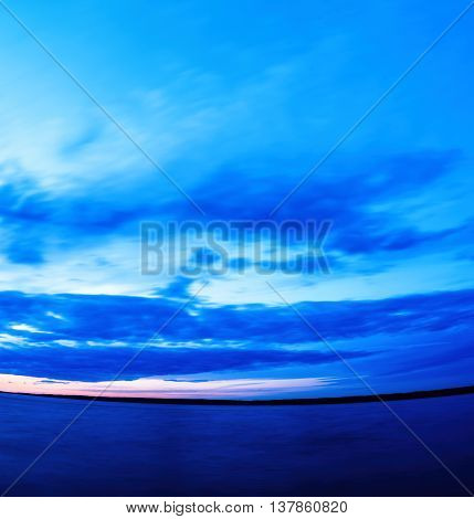 Vertical vivid super wide angle  ocean curved horizon with cloudscape background backdrop