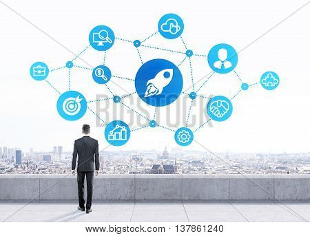 Start up concept with businessman looking at abstract rocket ship and other icons on city background