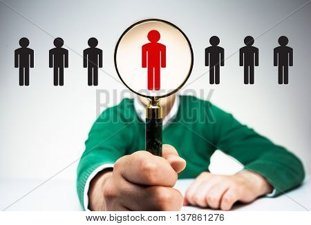 HR manager with magnifier choosing the right employee from variety of condidates. Human resources management and recruitment concept