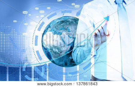 Global e-mail marketing concept. Businessman pointing at business chart top on digital background with globe and network.