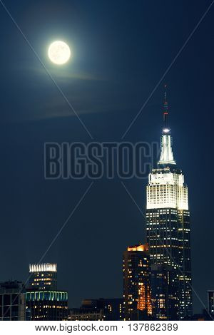 NEW YORK CITY, NY - SEP 20: Empire State Building with super moon on September 20, 2013 in New York City. It is a 102-story landmark and was world's tallest building for more than 40 years.
