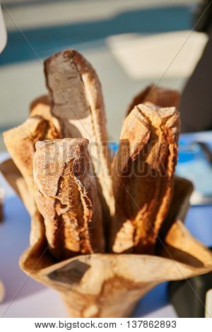 Traditional crusty French baguette bread in baskets. Shallow dof