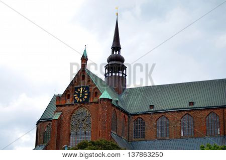 part of large catherdral and cloudy sky in stralsund, germany