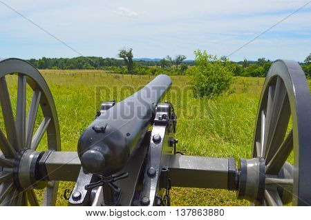 A Cannon at Gettysburg, Pennsylvania points as it would have during the Civil War to the area of Pickett's Charge