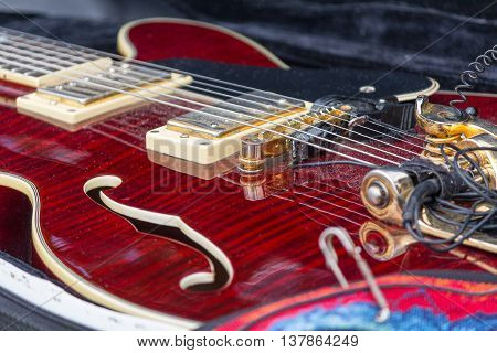 Neck electric guitar in a case close-up. Music