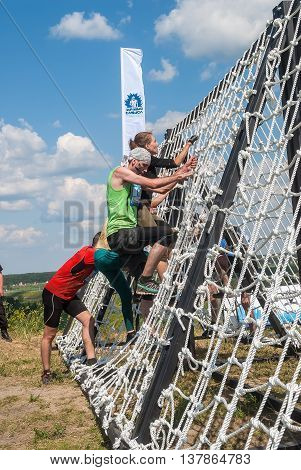Tyumen, Russia - July 9, 2016: Steel Character extrim race on Voronino Hill. Nets stage. Team storms net wall