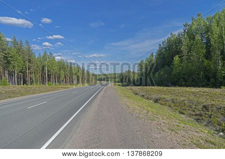 Federal Highway A121. Sunny day in June. South Karelia Russia.
