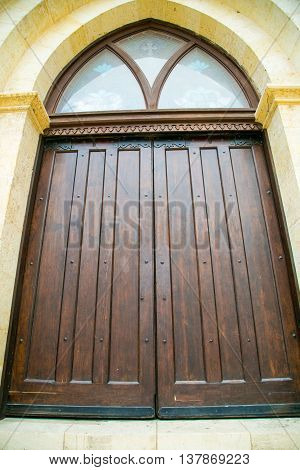 A large wooden door at a church in Texas.