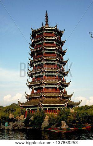 Guilin China - April 28 2006: The Moon Pagoda built on an island in Shan Hu Lake