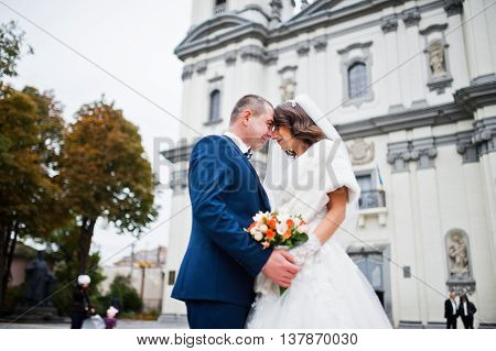 Wedding Couple Holding Hands And Looked Each Other Background Of Church
