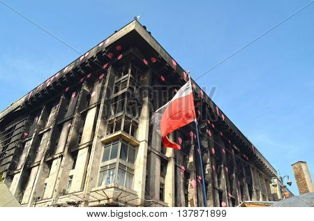 KIEV, UKRAINE -MAR 24, 2014: Downtown of Kiev.Burnt down the House of trade unions.Polish flag. Riot in Kiev .March 24 2014 Kiev, Ukraine