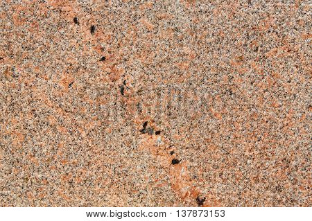 Red marble texture. Natural polished granit stone wall with grain surface, abstract background