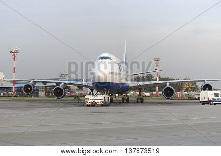 MOSCOW, RUSSIA - SEPTEMBER 26, 2014: Boeing 747 Transaero towed to the runway. Transaero Airlines has ceased to exist in 2015.