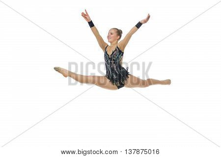 Gymnast girl in beautiful costume making jumping exercise. Isolated over white background. Copy space.
