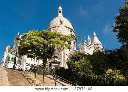 The Sacre Coeur basilica is a Roman Catholic church located at the summet of the butte Montmartre the highest point in Paris.