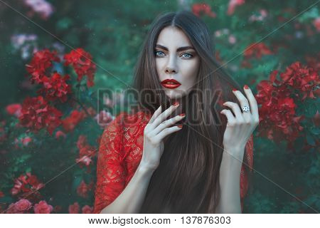 Close-up portrait of a woman surrounded by flowers.