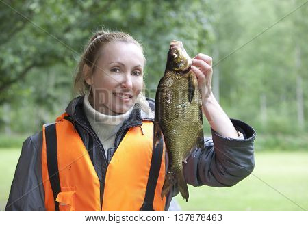 The young woman the fisherman with caught the bream