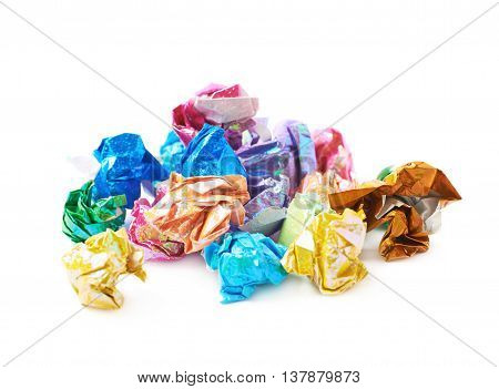 Pile of colorful crumbled origame paper sheet balls isolated over the white background