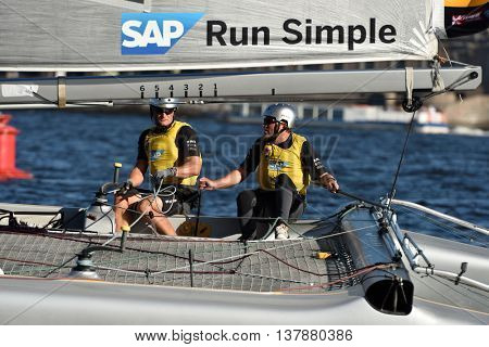 ST. PETERSBURG, RUSSIA - AUGUST 23, 2015: Catamaran of SAP Extreme Sailing Team from Denmark during St. Petersburg stage of Extreme Sailing Series. The Wave, Muscat team of Oman leading after 3 days