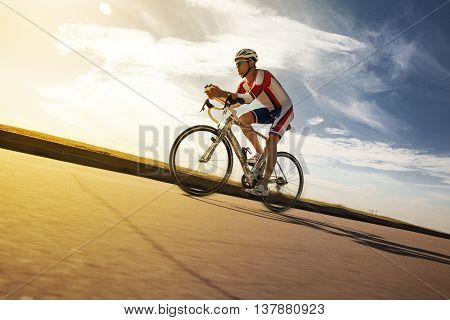 Cyclist overtaking a breeze. Triathlon. Summer Olympics