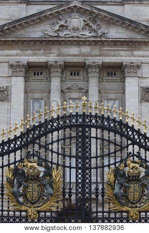 LONDON, UNITED KINGDOM - SEPTEMBER 11 2015: Architectural close up of iron Australia Gate with Buckhingham Palace behind in London United Kingdom