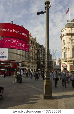 LONDON, UNITED KINGDOM - SEPTEMBER 11 2015: Piccadilly Circus in London view of the famous advertising neon signs with people walking around
