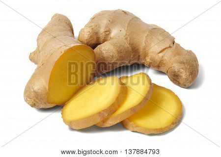 Slices of ginger root on white background