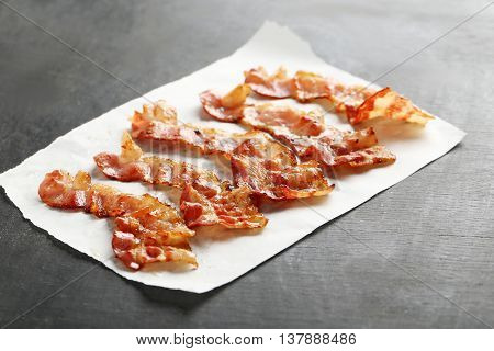Crispy Strips Of Bacon On A Black Wooden Background