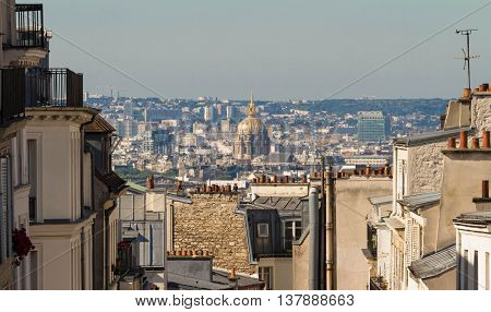 The Monmartre buildings and Saint Louis cathedral in the background Paris France.