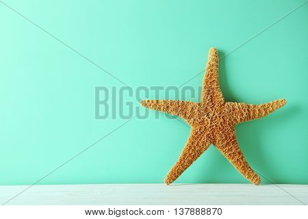 Starfish on a green wooden table, close up