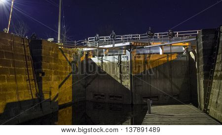 A Rideau canal lock interior, at Merickville Ontario as seen at night when the water is at a low level