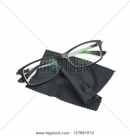 Glass cleaning black cloth napkin with a pair of glasses over it, composition isolated over the white background