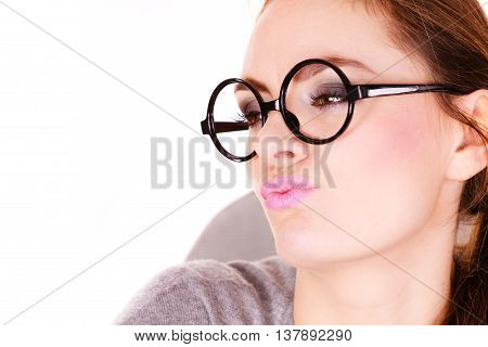 Attractive woman thinking seeks a solution doubtful young female businesswoman wearing glasses making decision serious face expression