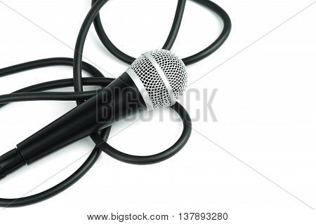 Microphone with cable on white background, vocal concept.