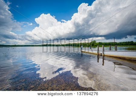Dramatic Storm Clouds Over A Dock In Massabesic Lake, In Auburn, New Hampshire.