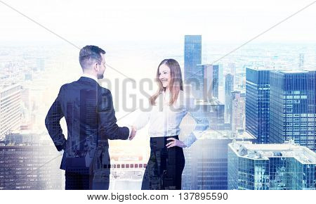 Business man and woman shaking hands on New York city background. Double exposure