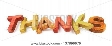 Word Thanks made of colored with paint wooden letters, composition isolated over the white background