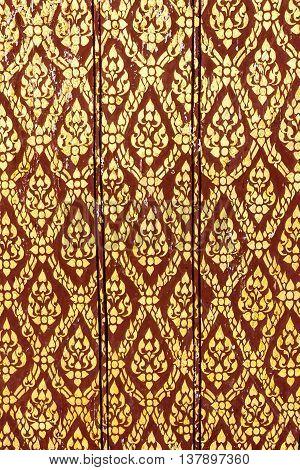 Thai art gold painting pattern on door Wat Thai in Thailand
