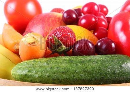 Fresh Fruits And Vegetables On Wooden Plate