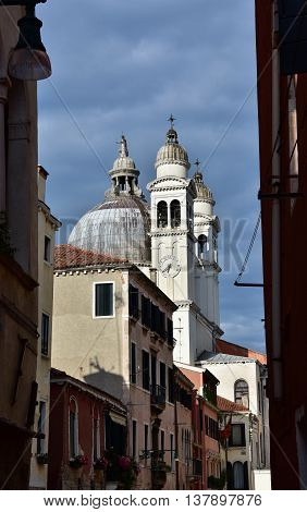 Santa Maria della Salute (St Mary of the Health) apse and belfries seen from a typical Venice narrow street