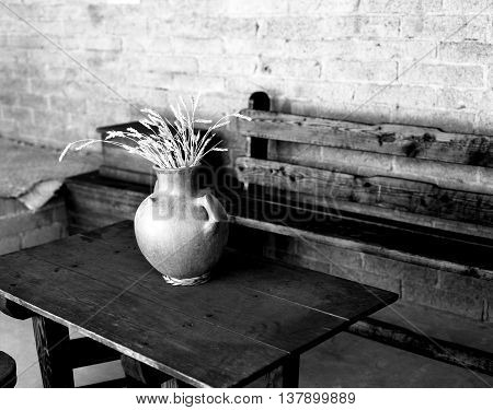 Still life of old pot and grain in old room