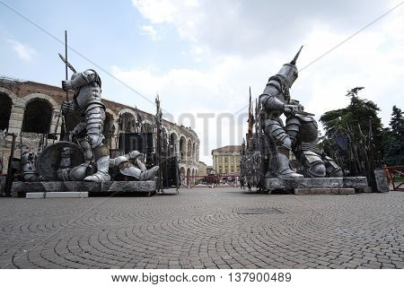 VERONA, ITALY - JULY, 2, 2016: sculpture of Gladiator infront of Arena of Verona (in Italian - Arena di Verona) - ancient amphitheatre used today as a stage for concerts and Opera performances
