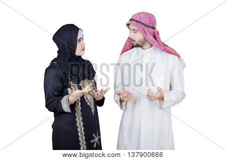Arabian young businessman talking with his partner in the studio isolated on white background