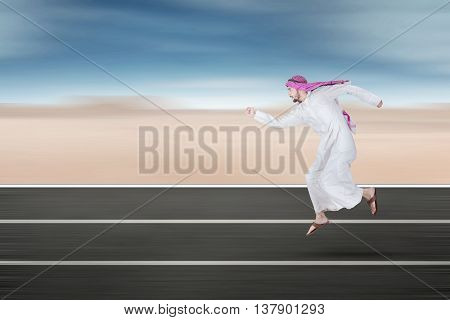 Arabic young businessman running on the street
