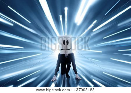 Businessperson with cardboard head ready to run and compete. shot with fast motion blur background