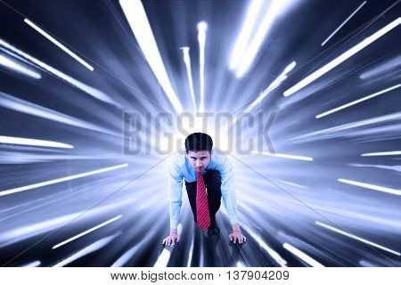 Male worker ready to run and compete with fast motion blur background