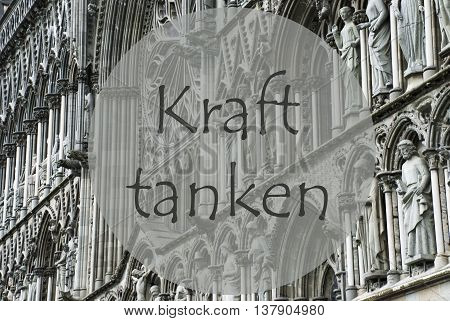 Church Of Trondheim In Norway. Macro Or Close Up Of Sculptures Or Statue. Religious Greeting Card. German Text Kraft Tanken Means Relax