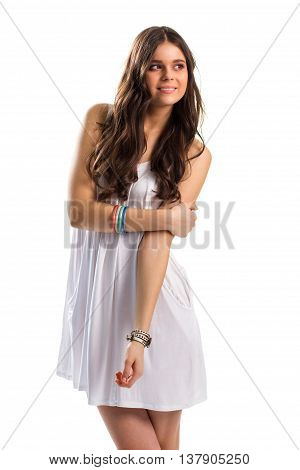 Girl in white sundress smiling. Woman looks to the side. Colors of good mood. Embodiment of kindness.